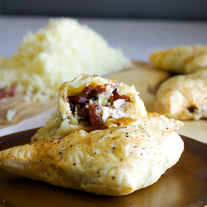 Cheese, bacon, date, and chipotle pepper turnovers.