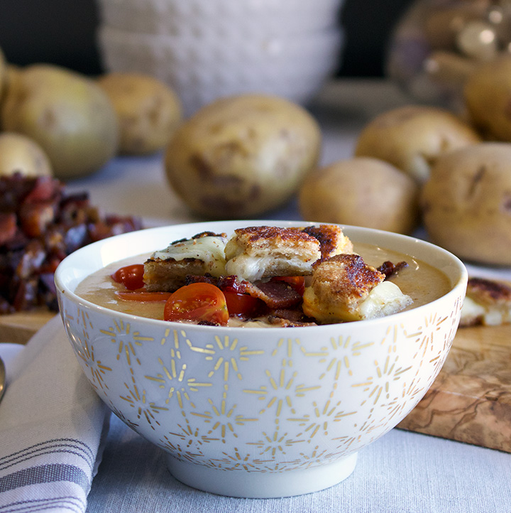 Potato Cheese Soup with Grilled Cheese Croutons, Artichokes, Green Chilies, Bacon, and Tomatoes