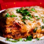 A plate of homemade classic lasagna with sausage and marinara.