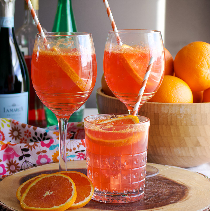 Three glasses of Aperol Spritz Cockails