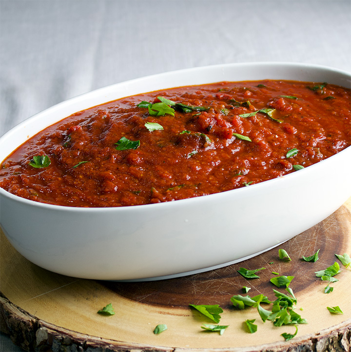 A large bowl of homemade marinara sauce.