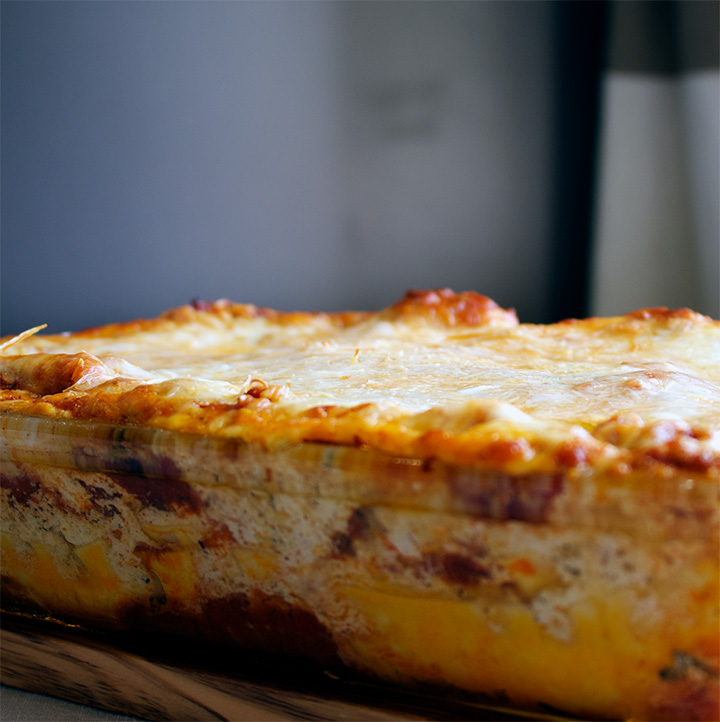 A pan of homemade classic lasagna with Italian sausage, the best marinara sauce, ricotta, mozzarella, and parmesan cheese.