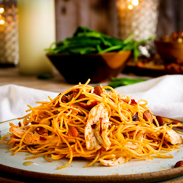 A plate of 20-Minute Garlic Chipotle Pasta with Roasted Chicken.