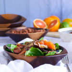 A bowl of roasted shiitake salad with oranges and citrus ponzu.
