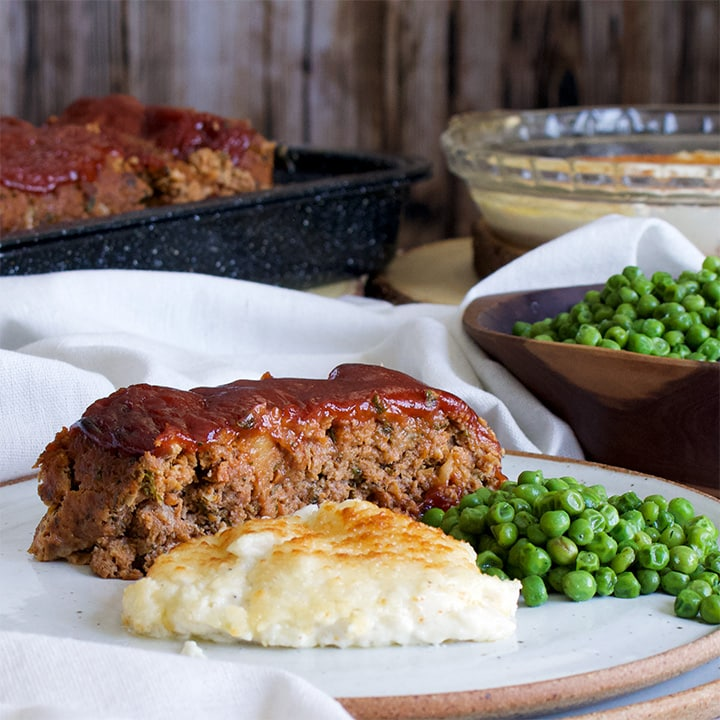 Classic Meatloaf with 10-minute au gratin potatoes and green peas.