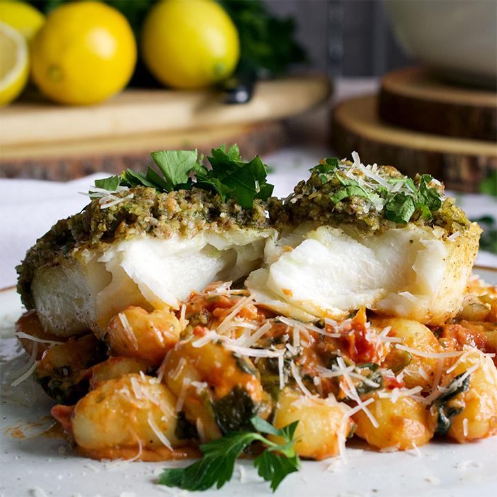 Pecan crusted halibut seared over creamy sun dried tomato and spinach gnocchi.