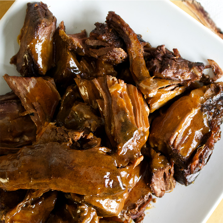 A plate of slow cooker tri-tip steak smothered in fennel and coriander gravy.