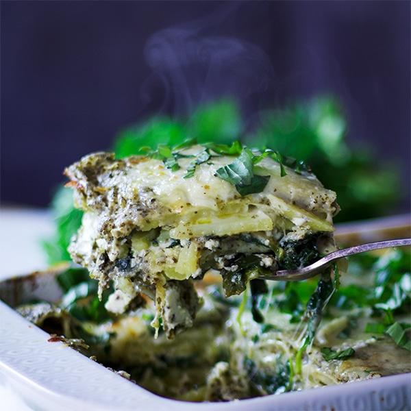 Serving a piece of Green Tea Pesto Potato Lasagna