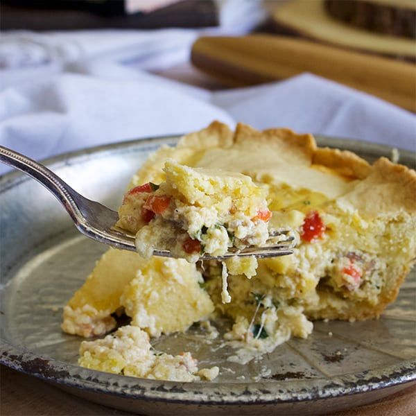 Taking a bite of Pizza Rustica (Italian Easter Pie)