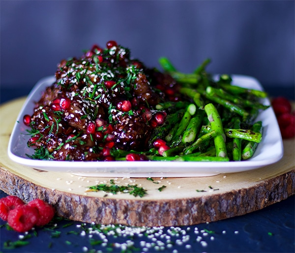 Pomegranate Raspberry Sesame Chicken with rice and asparagus