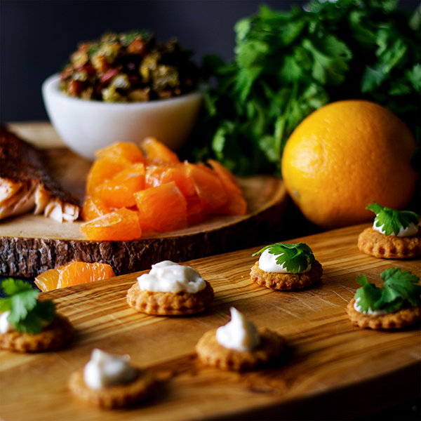 Building a tray of Orange Cedar Roasted Salmon Appetizers with Almond Chili Salsa