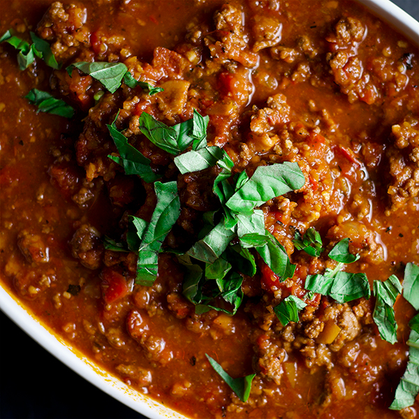 A large bowl of bolognese sauce