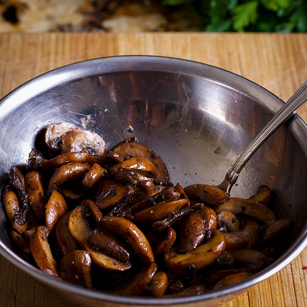 A bowl of sautéed crimini mushrooms.