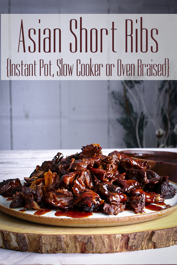 A plate of Asian Short Ribs covered in sauce on a table, ready to eat.