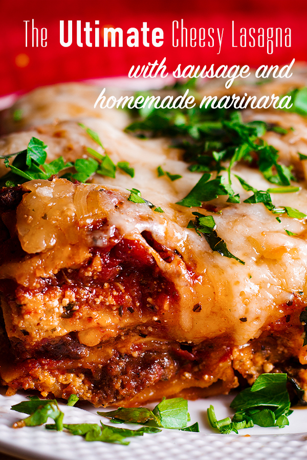 A piece of classic lasagna with homemade marinara and sausage on a plate.