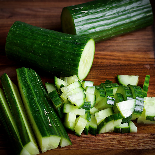 Chopping a cucumber for Israeli Salad.
