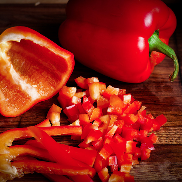 Chopping a red bell pepper.