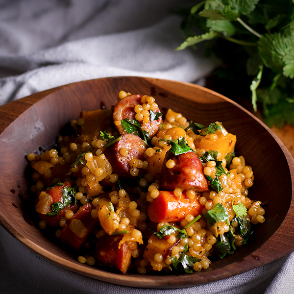 Couscous grain bowls with butternut squash and andouille sausage.