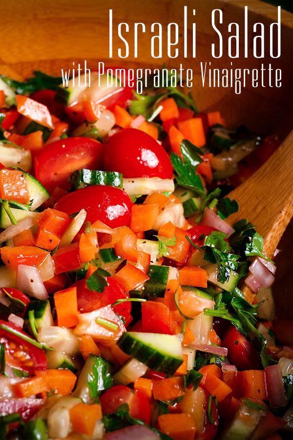 Tossing Israeli Salad with Pomegranate Vinaigrette.