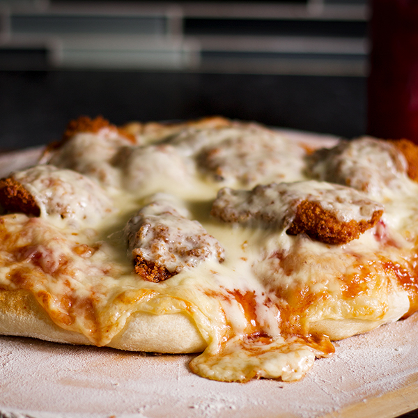 BBQ Fried Chicken Pizza, hot from the oven, with melted white cheddar cheese.