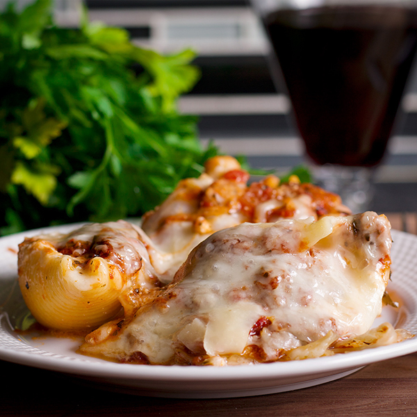 A plate of Cheesy Ricotta Stuffed Shells with Marinara Sauce.