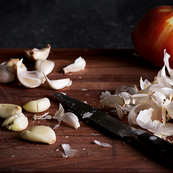 Chopping garlic and onions for The Ultimate Sheet Pan Dinner.