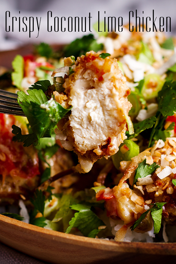 Taking a bite of Crispy Coconut Lime Fried Chicken with Creamy Coconut Lime Sauce