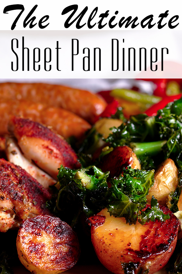 The Ultimate Sheet Pan Dinner with chicken, sausage, and several different kinds of vegetables, on a platter, ready to serve.