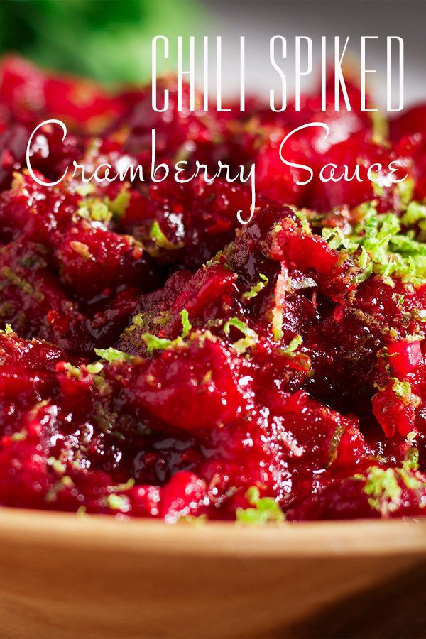 A bowl of chili cranberry sauce with lime zest sprinkled over the top.