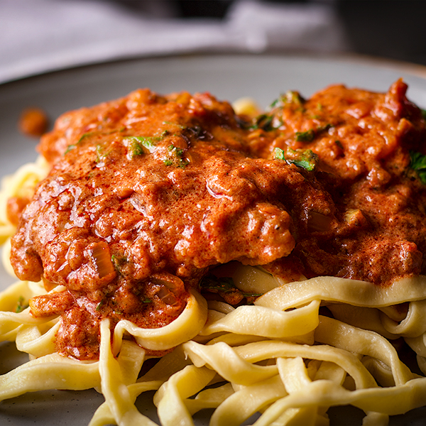 A plate of Chicken Paprikash with Buttered Egg Noodles.