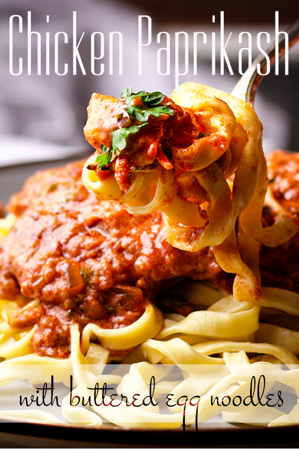 Taking a bite of Chicken Paprikash with Buttered Egg Noodles.