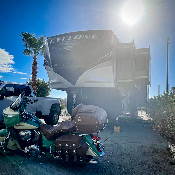 Our 5th wheel RV, truck, and motorcycle parked in Desert Hot Springs, California.