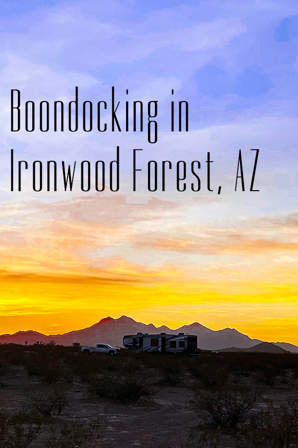 Our 5th wheel RV parked in Ironwood Forest National Monument with a spectacular sunset in the background.