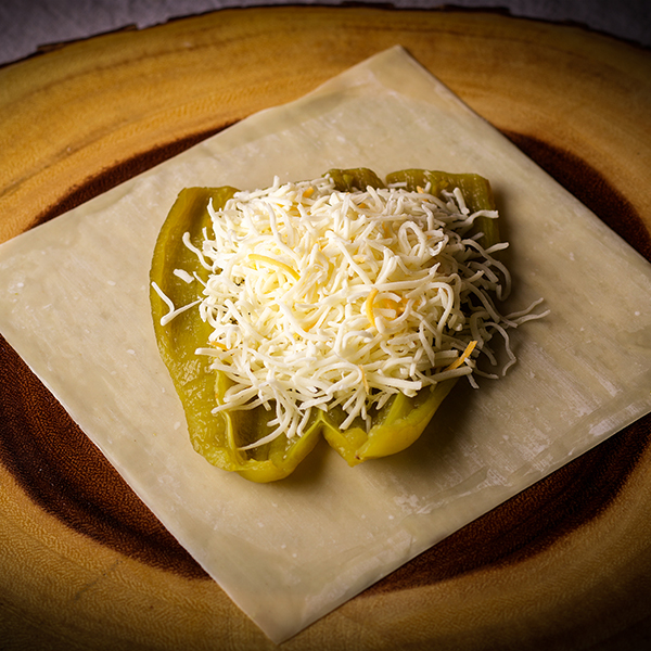 Making Chili Rellenos Step #2: Fill the green chili with about 1/2 cup shredded cheese.