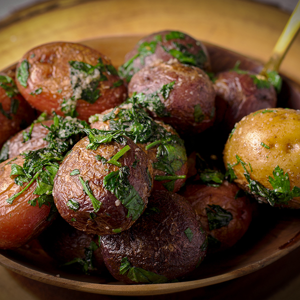 A bowl of parsley buttered potatoes.