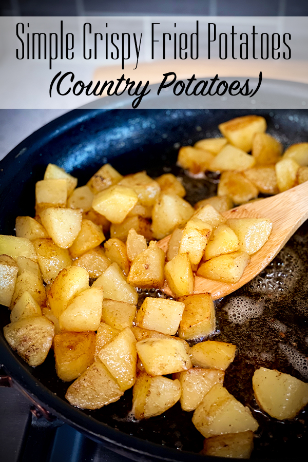 Cooking crispy fried potatoes in a skillet.