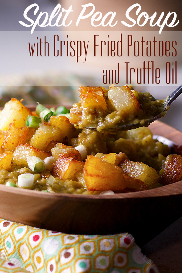 Taking a bite of split pea soup with ham and crispy fried potatoes with truffle oil.