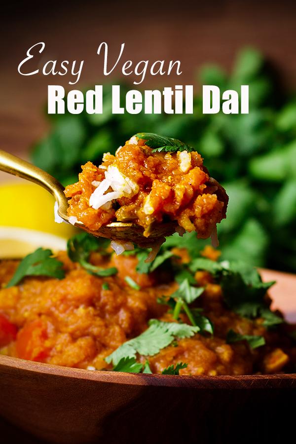 Taking a bite of red lentil dal.