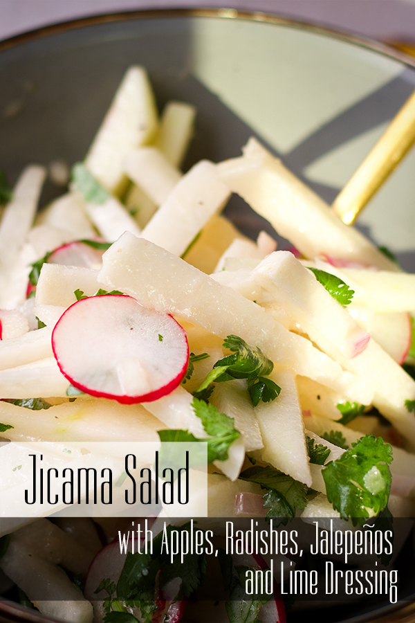 A bowl filled with jicama and apple salad with honey lime dressing.