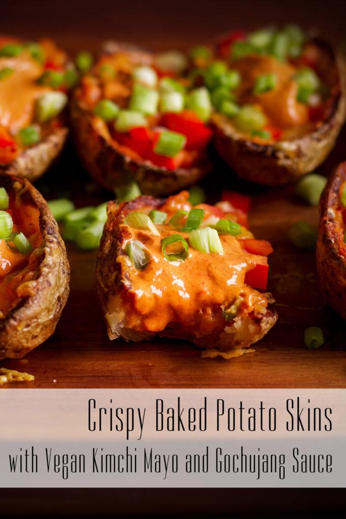 A tray of crispy potato skins. The middle potato skin has a bite taken out of it.