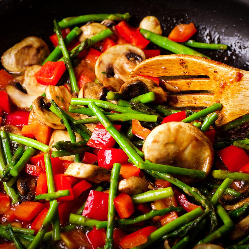 Sautéing vegetables in a skillet.