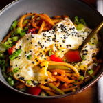 A bowl of Asian Noodles with Creamy Kimchi Sauce and a fried egg.
